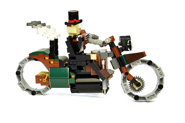 LEGO MOC - Steampunk Machine - Thomas Watts' Steam Motorcycle (Miniland): <br>Axle-free wheels with forged steel rim on the electrodynamic suspension are getting out from any scrape, be it rocks or quicksand.<br><br />
